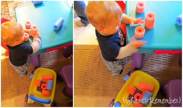 Baby Playing with Pool Noodles