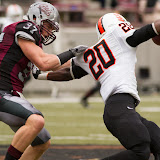 Redshirt junior linebacker Jordan Tripp tackles Idaho State running back Aaron Prier.  Tripp was a monster throughout Saturday's game, leading his Grizzlies to a 70-24 rout of the Bengals.  Washington-Grizzly Stadium in Missoula, Mont., October 27th, 2012.