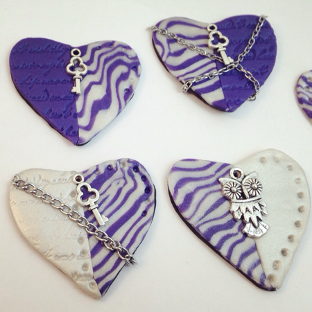 Examples of steampunk heart charms by Felicianation