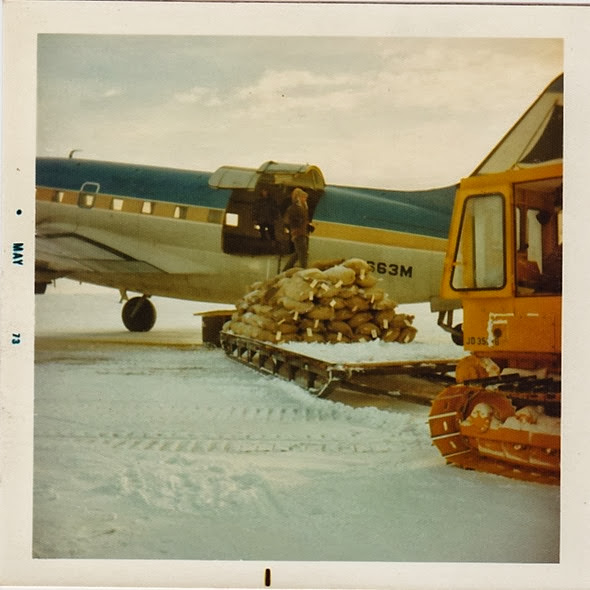 Loading C-46 w-tractor & sled_1973