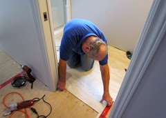 1410249 Oct 31 Terry Putting Floor Under Door