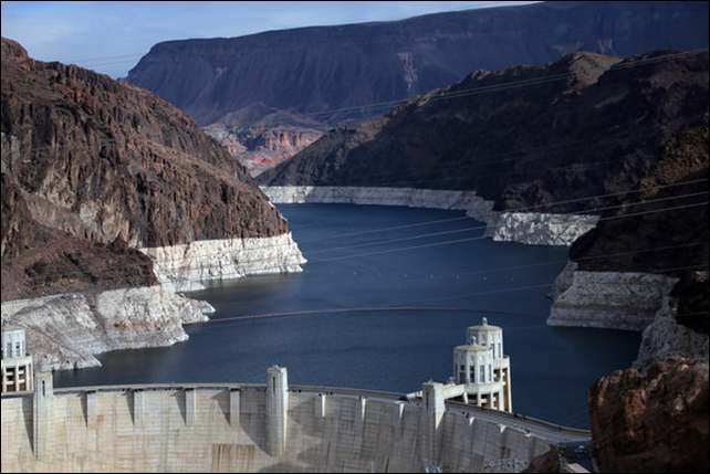 The 'bathtub ring' around Lake Mead is clearly visible, as the Colorado River level falls to record lows. To help the Colorado, federal authorities in 2014 will for the first time reduce the water flow into Lake Mead, the nation's largest reservoir, created by Hoover Dam. Photo: Jim Wilson / The New York Times