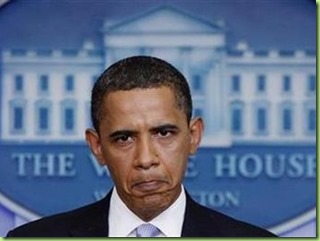 Barack_Obama_Frowning_in_Front_of_White_House_Seal