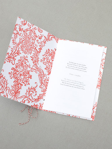 I also used the pattern on the interior of the ceremony booklet and bound the book together using pastry twine.