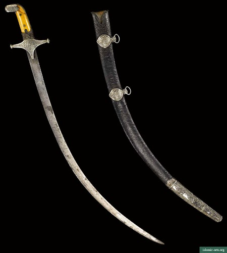 A SILVER MOUNTED SWORD WITH IVORY GRIPS AND SCABBARD, OMAN,