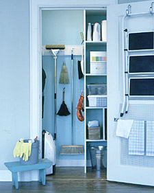 To help avoid clutter in a broom closet, make sure you only have what you need, nothing more. Use the wall and shelves to help keep the floor clear and group cleaning supplies by what room they're used in.