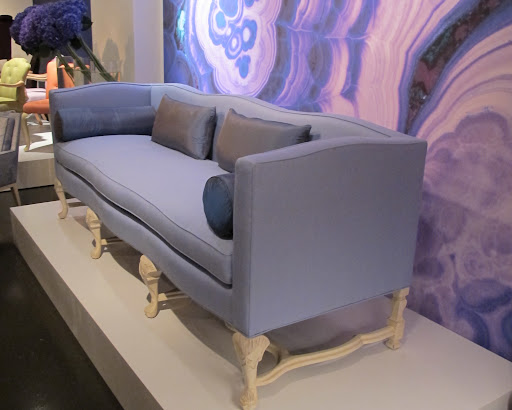 This neo-baroque fabulous violet sofa is such a burst of  lively color against that gemstone wall art.