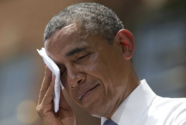 President Barack Obama wipes sweat from his head during a speech on climate change, Tuesday, 25 June 2013, at Georgetown University in Washington. Obama is proposing sweeping steps to limit heat-trapping pollution from coal-fired power plants and to boost renewable energy production on federal property. Photo: Evan Vucci