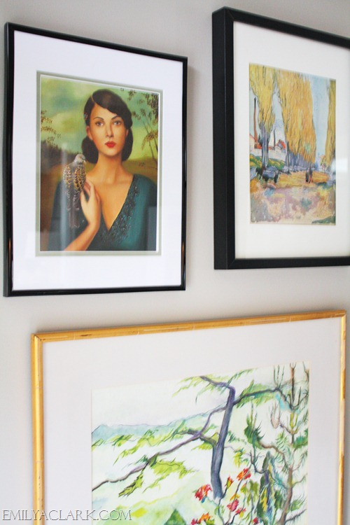 framed paintings on gallery wall