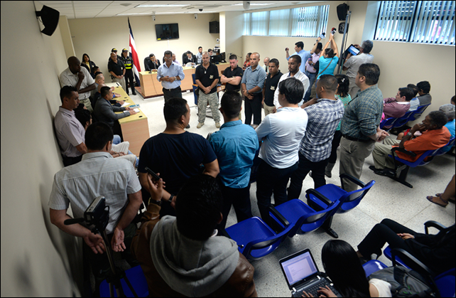 Press and family members of the seven men accused of murdering Costa Rican sea turtle conservationist Jairo Mora packed a Limón courtroom on 26 January 2015 as the defendants were acquitted of the murder. Photo: Lindsay Fendt / The Tico Times