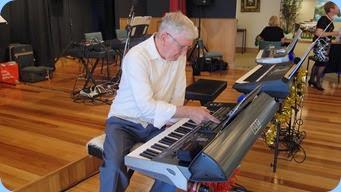 President, Gordon Sutherland, preparing his Korg Pa3X before playing a few pieces. Photo courtesy of Dennis Lyons.