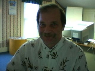 working at the 124 East Spruce Avenue office in a favorite Chinese shirt I received as a gift from friends visit to Hanoi Vietnam.