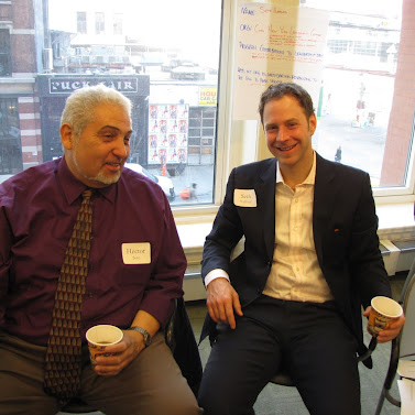 Hector Soto from the Center for Neighborhood Leadership and Seth Hufford from the Coro Fellowship Program talk at an RCLA event for leadership program directors.
