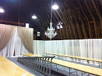 The last step before covering and decorating the tables was to hang two crystal chandeliers.