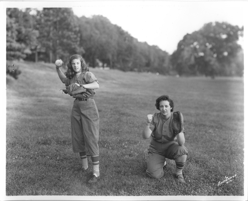 Two women in uniform playing softball, Kansas City. Circa 1920-1935.