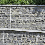 9 - Walls of squared rubble stone and wall coping
