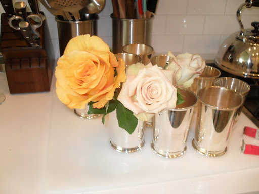 Using clean vases is very important for the flowers, also the warmer the water the faster the roses will open.