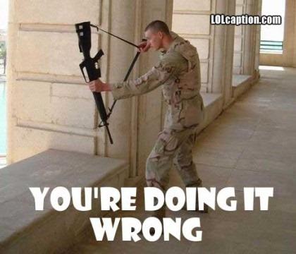 funny-picture-marine-machine-gun-crossbow-fail-420x360