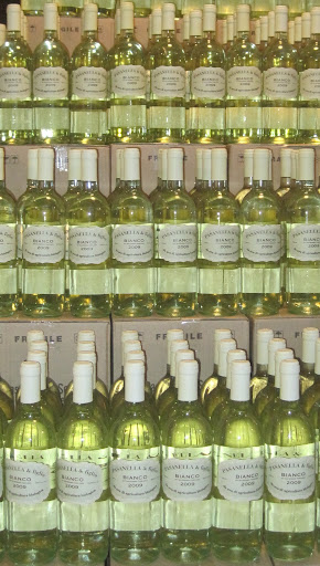 Take a cue from your local wine shop and display multiple bottles of your favorite wine, the prettier the label the better. (pasanellaandson.com)
