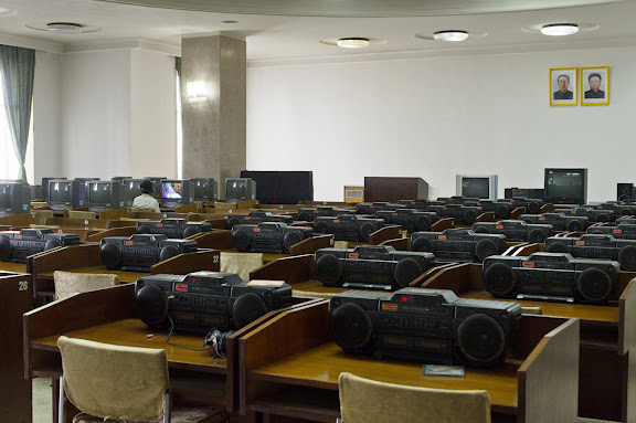 Cultural education room with TV's and Boomboxes at Grand People's Study House, North Koreas biggest library and educational centre.  It has a total floor space of 100,000m2 and 600 rooms. Foreign publications are available only with special permission.