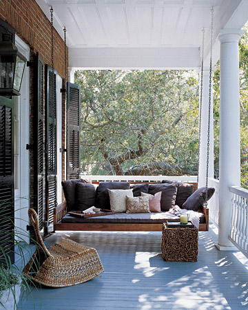 A shutter is attached to the exteriors of windows -- giving the house facade added detail and protection from harsh conditions if need be.  (Martha Stewart Living)