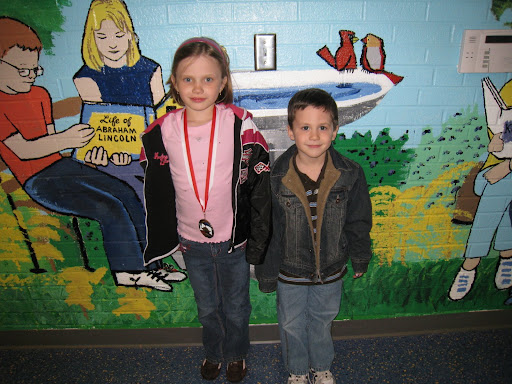 Natalie (with medal) and Eli pose in school entry