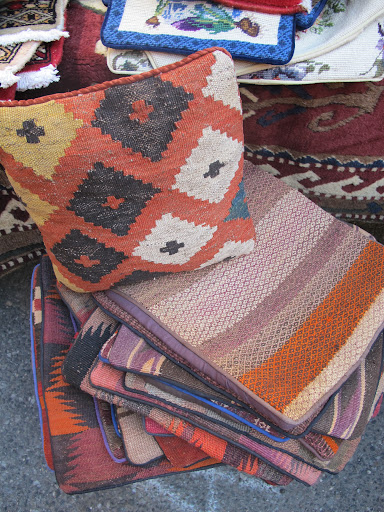 The same vendor sold these pillow covers and other textiles.