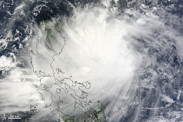 The Moderate Resolution Imaging Spectroradiometer (MODIS) on NASA's Terra satellite captured this natural-color image of Tropical Storm Kai-tak on 13 August 2012. Storm clouds stretched across the northern Philippines, although Kai-tak lacked a distinct eye. NASA image courtesy Jeff Schmaltz, LANCE MODIS Rapid Response Team at NASA GSFC