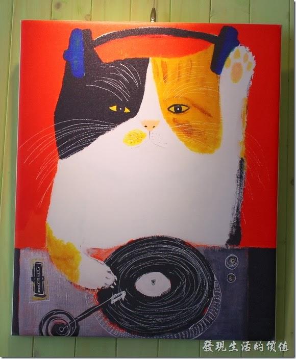 台南-小莫里。【Komori】餐廳的牆壁上有幾幅可愛貓咪的畫像。