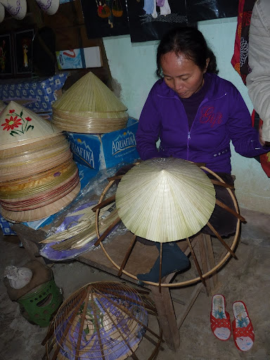 A local demonstration of the ubiquitous conical hats, which are amazingly enough available to buy there and then.