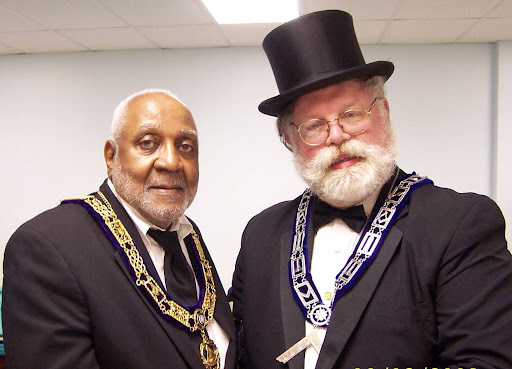 MW Lew Myrick and RW Carl G. Ek, Worshipful Master. Unity Lodge No. 148, New Britain, at the Recognition Table Lodge. MW Myrick was protagonist for recognition twenty year ago, and RW Ek is the author of this series.