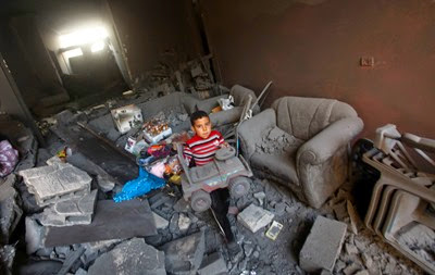 Palestinian_Boy_Toy_Debris_Destroyed_Home_Following_Israeli_Air-Strike_Gaza_City