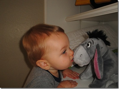 6.  Giving Eeyore kisses