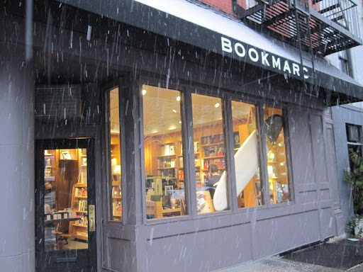 Outside of the BookMarc shop in the West Village of NYC. Check out the surf board in the window!