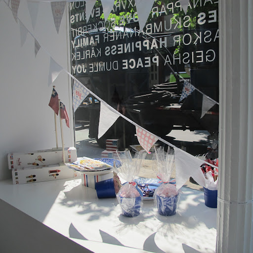 Red, white and blue bunting decorates the window.