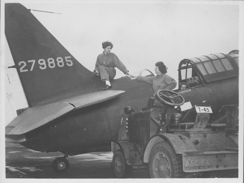 Women's Army Corps (WACS) servicewomen L. Weber, Esther Fromm, and Marvyl working on a plane at Patterson Field. Circa 1944.