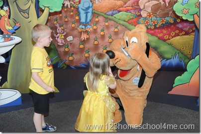 Pluto signing autograph at Disney Epcot