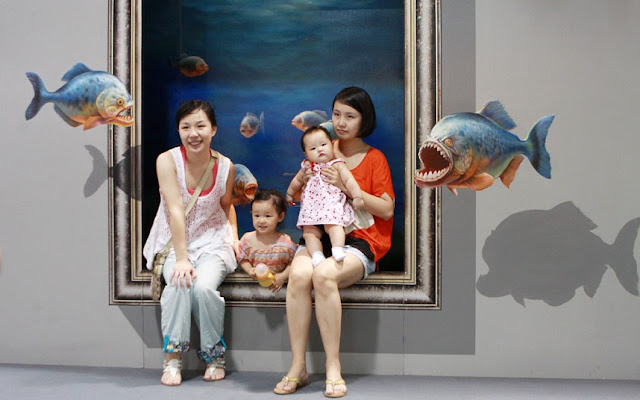 3D Painting Exhibition In Hangzhou...HANGZHOU, CHINA - JULY 01: People pose with a 3D painting during the 2012 Magic Art Special Exhibition Of China at Hangzhou Peace International Exhibition and Conference Center on July 1, 2012 in Hangzhou, China. The exhibition will run from July 1 to August 6 in Hangzhou.  PHOTOGRAPH BY China Foto Press / Barcroft Media  UK Office, London. T +44 845 370 2233 W www.barcroftmedia.com  USA Office, New York City. T +1 212 796 2458 W www.barcroftusa.com  Indian Office, Delhi. T +91 11 4053 2429 W www.barcroftindia.com