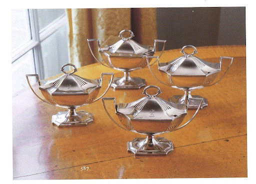 These boat shaped sauce tureens are perfect.  Loving their angular handles with reeded edges.