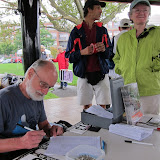 Paul Schell at the registration table.