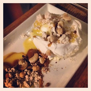 Lemon pavlova with peanut butter dust