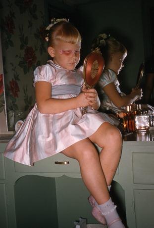 Judy sitting on vanity