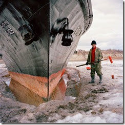 with-his-ship-frozen-in-the-lena-river-in-zhigansk-sailor-vladimir-egorevich-kuchev-uses-the-opportunity-to-apply-a-fresh-coat-of-paint-fishing-hunting-and-cattle-bree