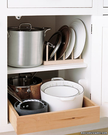 Having a rack to organize pots' and pans' lids will save you a lot of time from digging through your cabinets when you are cooking.