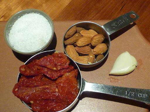 Ingredients for a sundried tomato pesto.