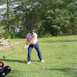 Pam practices golf swing.