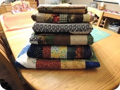 108.Stack of scraps quilts
