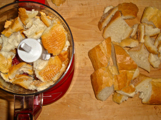 Break the bread up into chunks (or scoop out the soft inside and just use that). In batches, pulse them in a food processor until they're a size you like.