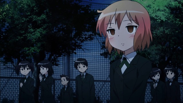 A very dark scene of Kotoura walking to school looking emotionless as other students whisper and look her way in the background
