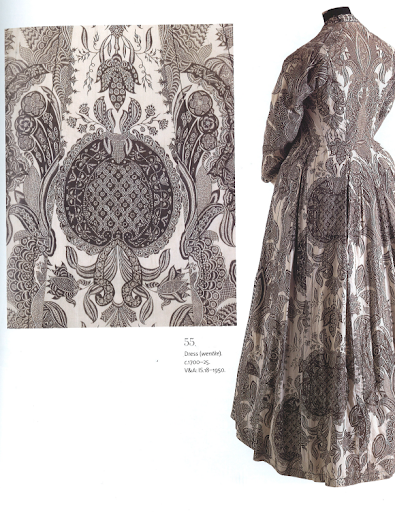 Talk about high-fashion! This dress is made of a rare example of chintz fabric, as it doesn't feature the characteristic bright colors. Dress circa 1800-1950.